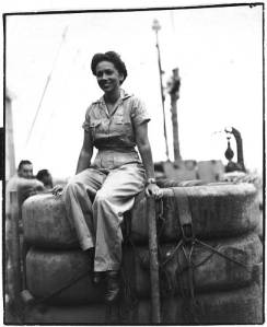 Ethel Palma seated on USS Evangeline, 1945