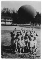 """Photo of WACs playing with a giant ball in a game of """"push ball"""" at Third WAC Training Center,Fort Oglethorpe, Georgia, circa 1944. The University of North Carolina at Greensboro, University Libraries, PO Box 26170, Greensboro NC 27402-6170, 336.334.5304 -- http://library.uncg.edu/"""