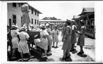 WACs at Fort Oglethorpe, Georgia, gather for mail call in April 1944. The University of North Carolina at Greensboro, University Libraries, PO Box 26170, Greensboro NC 27402-6170, 336.334.5304 -- http://library.uncg.edu/