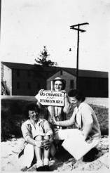 """Mildred Curtis Scott and two fellow WACs stand in front of sign reading """"Gas Chamber and Decontamination Area"""", circa 1944. The University of North Carolina at Greensboro, University Libraries, PO Box 26170, Greensboro NC 27402-6170, 336.334.5304 -- http://library.uncg.edu/"""